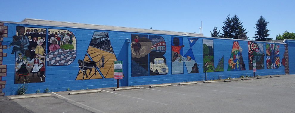 street art that reads Parkland with various city scenes depicted